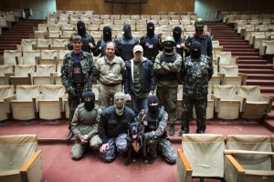 Masked pro-Russian protesters pose for a picture inside a regional government building in Donetsk